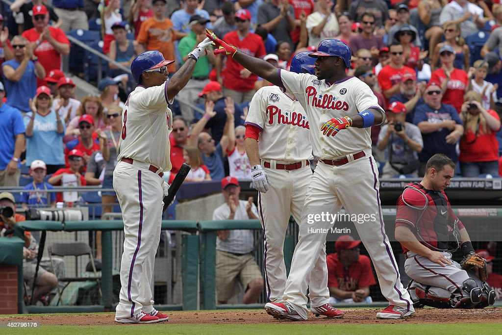 <a gi-track='captionPersonalityLinkClicked' href=/galleries/search?phrase=Ryan+Howard&family=editorial&specificpeople=551402 ng-click='$event.stopPropagation()'>Ryan Howard</a> #6 of the Philadelphia Phillies is congratulated by Marlon Byrd #3 after hitting a two-run home run in the first inning during a game against the Arizona Diamondbacks at Citizens Bank Park on July 27, 2014 in Philadelphia, Pennsylvania.