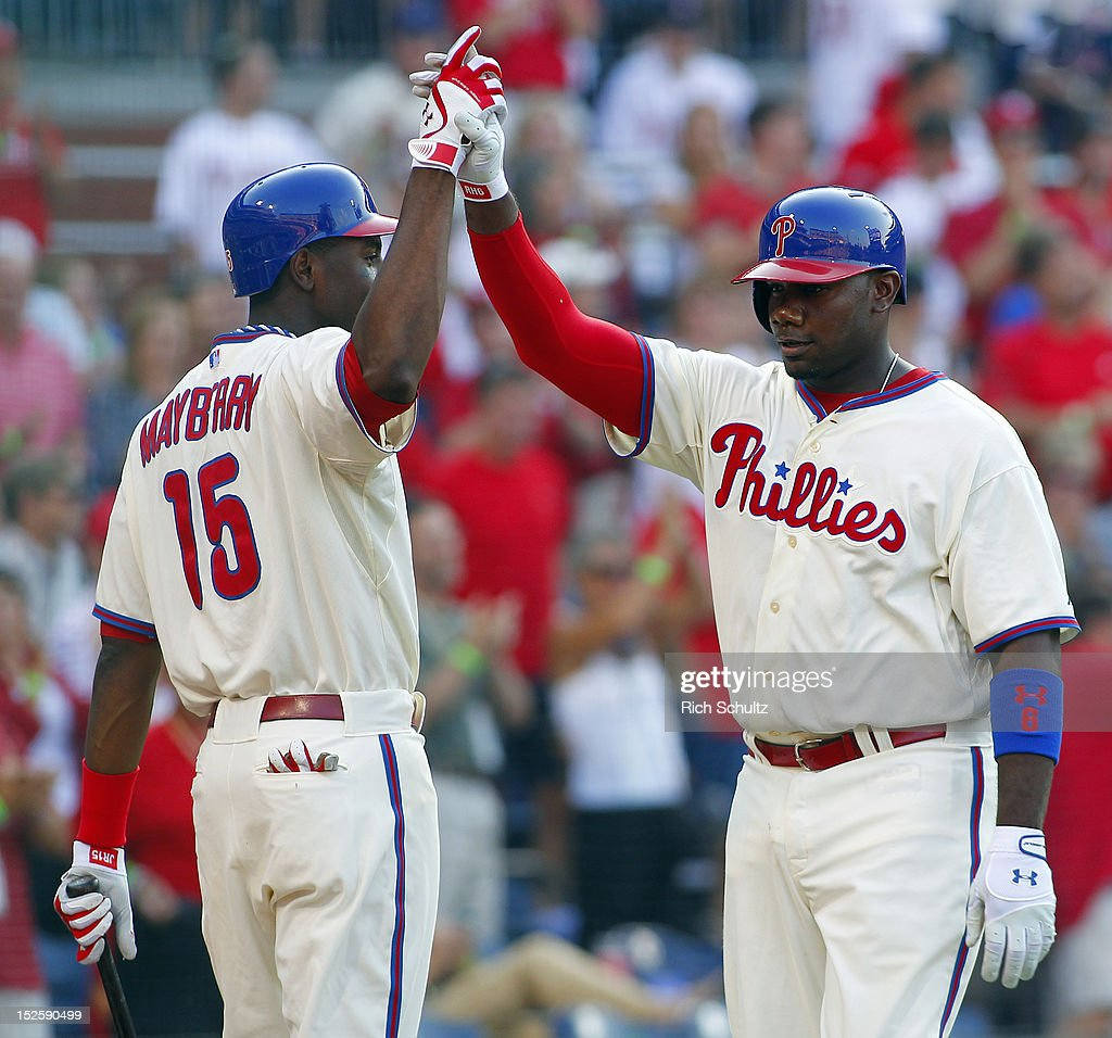 <a gi-track='captionPersonalityLinkClicked' href=/galleries/search?phrase=Ryan+Howard&family=editorial&specificpeople=551402 ng-click='$event.stopPropagation()'>Ryan Howard</a> #6 of the Philadelphia Phillies is congratulated by teammate John Mayberry #15 after hitting a solo home run against the Atlanta Braves during fourth inning in a MLB baseball game on September 22, 2012 at Citizens Bank Park in Philadelphia, Pennsylvania. The Braves defeated the Phillies 8-2.