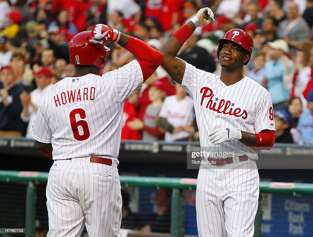 <a gi-track='captionPersonalityLinkClicked' href=/galleries/search?phrase=Ryan+Howard&family=editorial&specificpeople=551402 ng-click='$event.stopPropagation()'>Ryan Howard</a> #6 of the Philadelphia Phillies is congratulated by teammate Domonic Brown #9 after hitting a home run against the Miami Marlins during the second inning in a MLB baseball game on May 3, 2013 at Citizens Bank Park in Philadelphia, Pennsylvania.