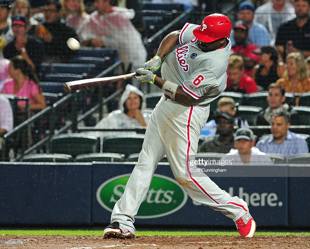 Ryan Howard #6 of the Philadelphia Phillies knocks in two runs with a sixth inning single inning against the Atlanta Braves at Turner Field on July 18, 2014 in Atlanta, Georgia.