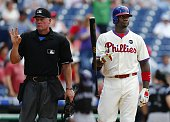 Ryan Howard of the Philadelphia Phillies reacts to a called strike three by home plate umpire Ted Barrett left in the eighthth inning against the...