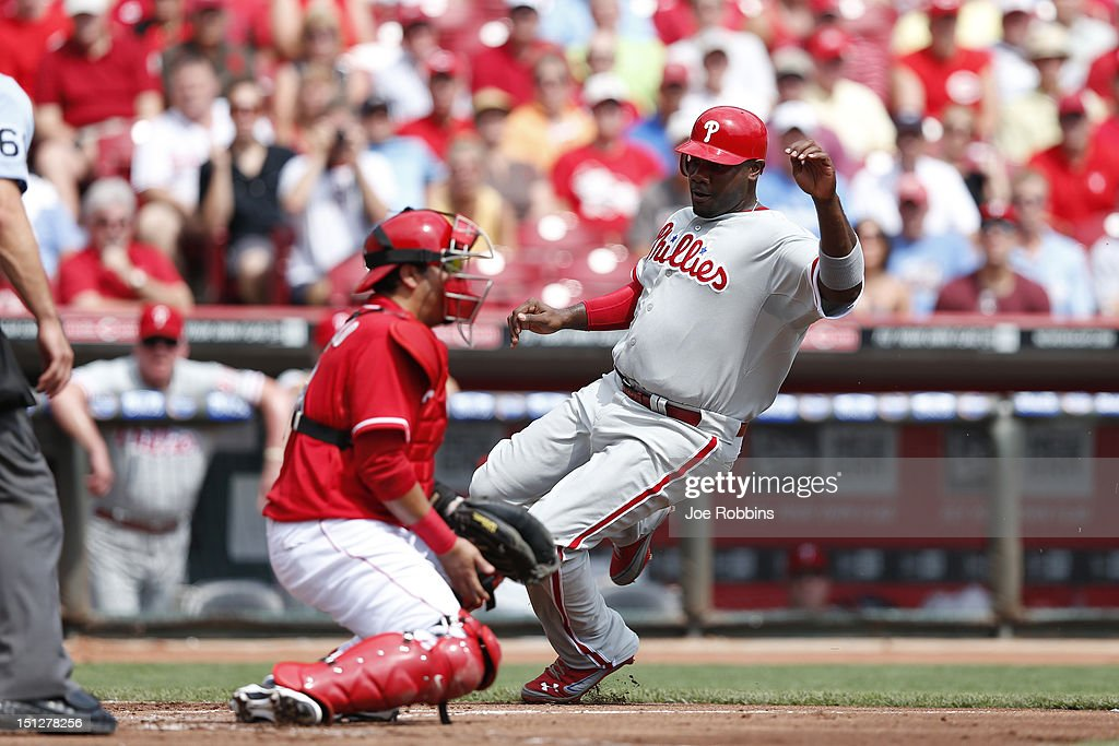 <a gi-track='captionPersonalityLinkClicked' href=/galleries/search?phrase=Ryan+Howard&family=editorial&specificpeople=551402 ng-click='$event.stopPropagation()'>Ryan Howard</a> #6 of the Philadelphia Phillies slides at home plate to score a run after a single by Domonic Brown in the second inning of the game against the Cincinnati Reds at Great American Ball Park on September 5, 2012 in Cincinnati, Ohio.