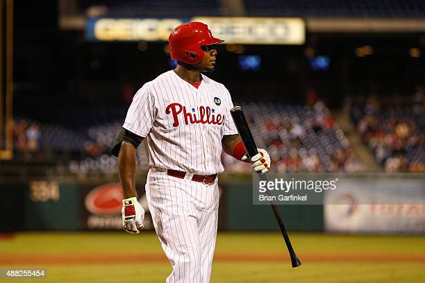 Ryan Howard of the Philadelphia Phillies walks back to the dugout after striking out in the sixth inning of the game against the Washington Nationals...
