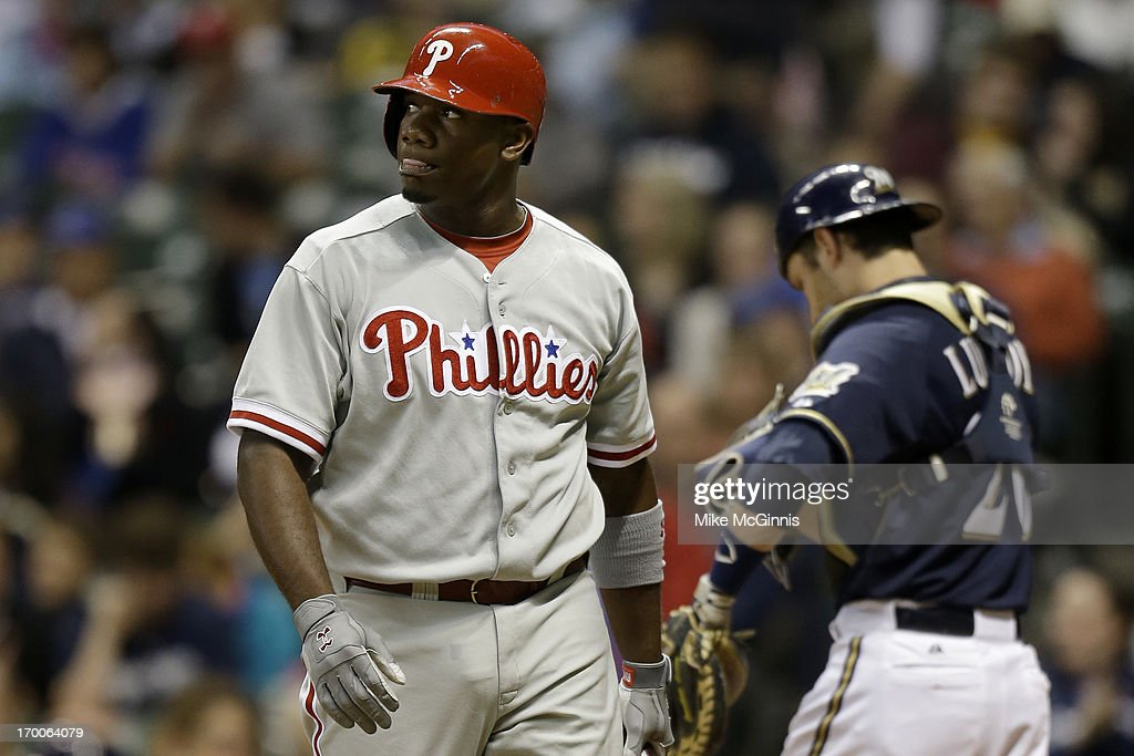 <a gi-track='captionPersonalityLinkClicked' href=/galleries/search?phrase=Ryan+Howard&family=editorial&specificpeople=551402 ng-click='$event.stopPropagation()'>Ryan Howard</a> #6 of the Philadelphia walks to the dugout after striking out in the top of the third inning against the Milwaukee Brewers during the game at Miller Park on June 06, 2013 in Milwaukee, Wisconsin.