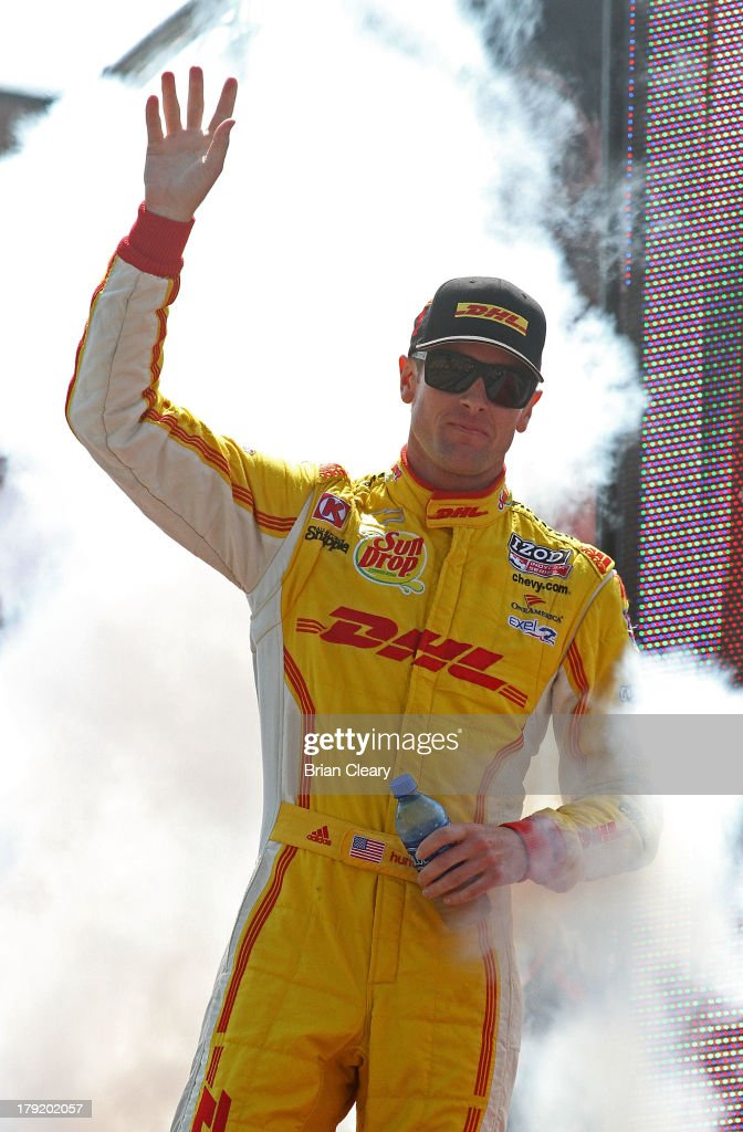 Ryan Hunter-Reay, driver of the #1 Andretti Autosport Chevrolet Dallara waves to fans before the Grand Prix of Baltimore on September 1, 2013 in Baltimore, Maryland.