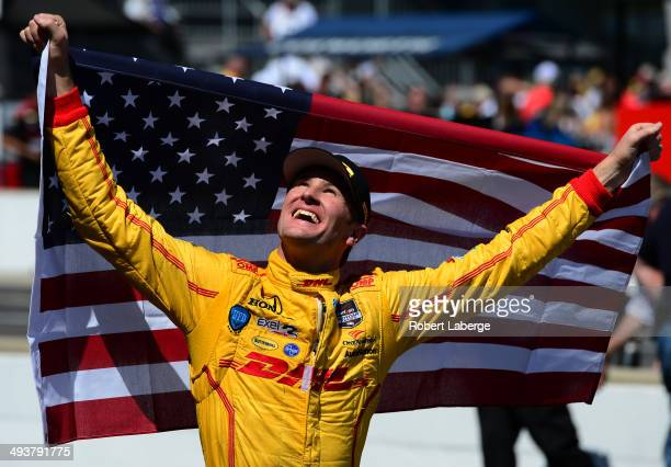 Ryan HunterReay driver of the Andretti Autosport Dallara Honda celebrates after winning the 98th running of the Indianapolis 500 mile race at the...