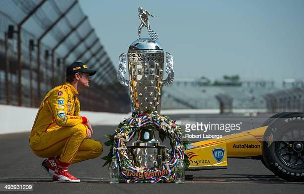Ryan HunterReay driver of the Andretti Autosport Dallara Honda kisses the Borg Warner Trophy at the yard of bricks during the Indianapolis 500 Mile...