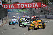 Ryan HunterReay driver of the Andretti Autosport Dallara Honda leads a pack of cars on the track during the Verizon IndyCar Series Toyota Grand Prix...