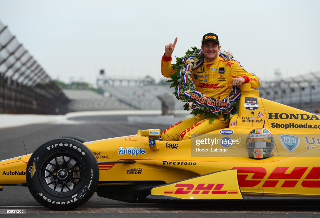 <a gi-track='captionPersonalityLinkClicked' href=/galleries/search?phrase=Ryan+Hunter-Reay&family=editorial&specificpeople=2197753 ng-click='$event.stopPropagation()'>Ryan Hunter-Reay</a> driver of the #28 Andretti Autosport Dallara Honda poses with the Borg Warner Trophy at the yard of bricks during the Indianapolis 500 Mile Race Trophy Presentation and Champions Portrait Session at the Indianapolis Motor Speedway on May 26, 2014 in Indianapolis, Indiana.