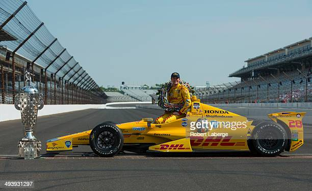 Ryan HunterReay driver of the Andretti Autosport Dallara Honda poses with the Borg Warner Trophy at the yard of bricks during the Indianapolis 500...