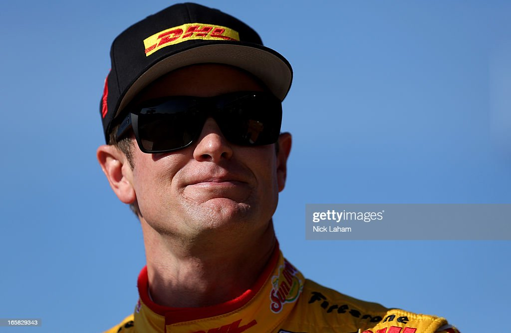 Ryan Hunter-Reay, driver of the Andretti Autosport DHL Chevrolet, stands on pit road after practice for the Honda Indy Grand Prix of Alabama at Barber Motorsports Park on April 6, 2013 in Birmingham, Alabama.