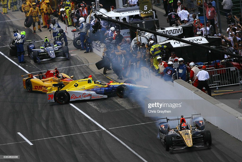 Ryan Hunter-Reay, driver of the #28 DHL Andretti Autosport Honda, and Towsend Bell, driver of the #29 Andretti Autosport Honda, make contact leaving the pits during the 100th running of the Indianapolis 500 at Indianapolis Motorspeedway on May 29, 2016 in Indianapolis, Indiana.