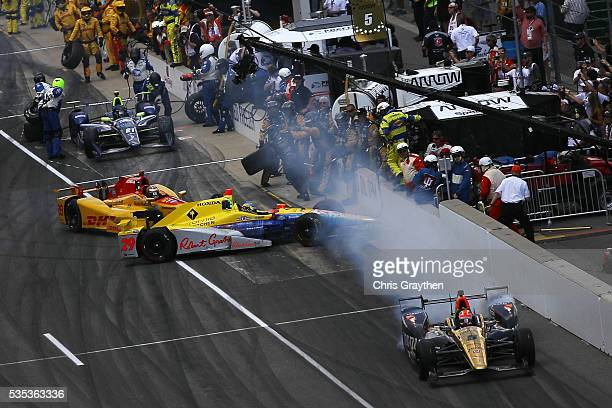 Ryan HunterReay driver of the DHL Andretti Autosport Honda and Towsend Bell driver of the Andretti Autosport Honda make contact leaving the pits...
