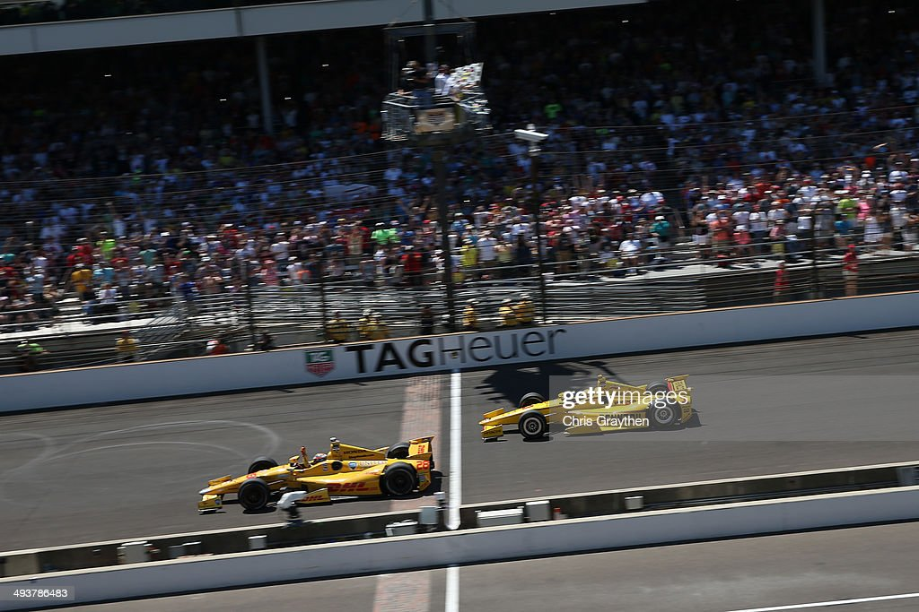 <a gi-track='captionPersonalityLinkClicked' href=/galleries/search?phrase=Ryan+Hunter-Reay&family=editorial&specificpeople=2197753 ng-click='$event.stopPropagation()'>Ryan Hunter-Reay</a>, driver of the #28 DHL Andretti Autosport Honda Dallara, crosses the finish line to win the 98th running of the Indianapolis 500 Mile Race at Indianapolis Motorspeedway on May 25, 2014 in Indianapolis, Indiana.