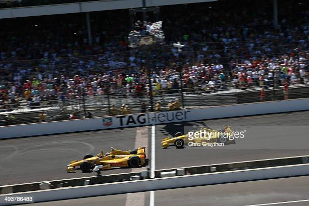 Ryan HunterReay driver of the DHL Andretti Autosport Honda Dallara crosses the finish line to win the 98th running of the Indianapolis 500 Mile Race...