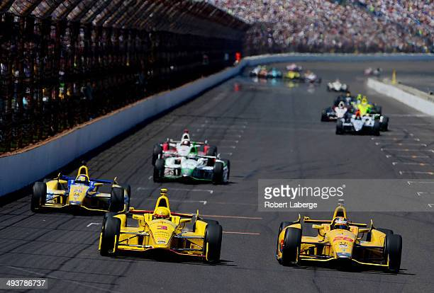 Ryan HunterReay driver of the DHL Andretti Autosport Honda Dallara Helio Castroneves of Brazil driver of the Pennzoil Ultra Platinum Penske Chevrolet...