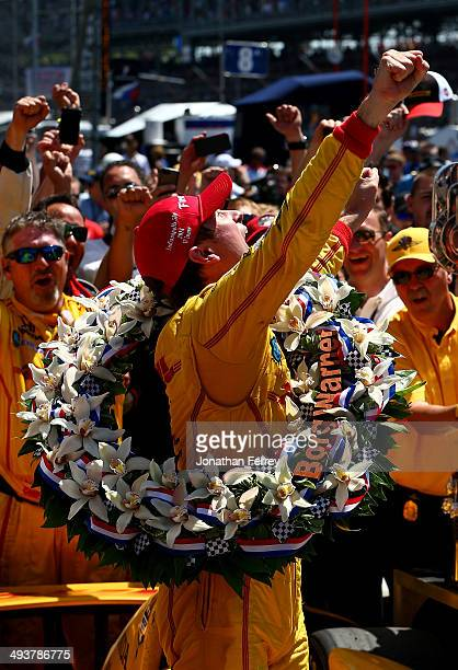 Ryan HunterReay driver of the DHL Andretti Autosport Honda Dallara celebrates in Victory Lane after winning the 98th running of the Indianapolis 500...