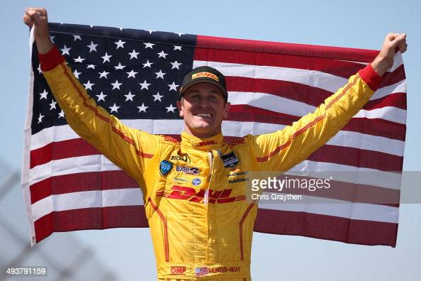 Ryan HunterReay driver of the DHL Andretti Autosport Honda Dallara celebrates after winning the 98th running of the Indianapolis 500 Mile Race at...