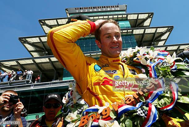Ryan HunterReay driver of the DHL Andretti Autosport Honda Dallara celebrates after winning the 98th running of the Indianapolis 500 at Indianapolis...