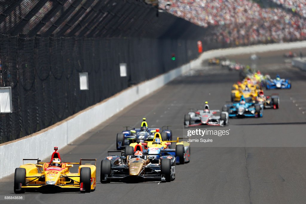 <a gi-track='captionPersonalityLinkClicked' href=/galleries/search?phrase=Ryan+Hunter-Reay&family=editorial&specificpeople=2197753 ng-click='$event.stopPropagation()'>Ryan Hunter-Reay</a>, driver of the #28 DHL Andretti Autosport Honda, leads a pack of cars during the 100th running of the Indianapolis 500 at Indianapolis Motorspeedway on May 29, 2016 in Indianapolis, Indiana.