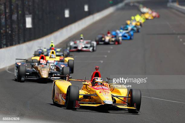 Ryan HunterReay driver of the DHL Andretti Autosport Honda leads the field during the 100th running of the Indianapolis 500 at Indianapolis...