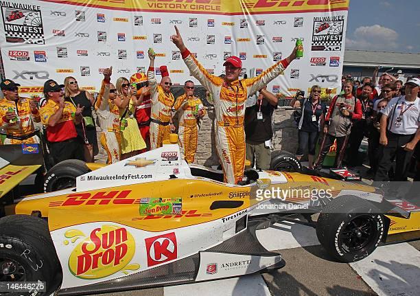Ryan HunterReay driver of the Team DHL/Sun Drop Citrus Soda Andretti Autosport Chevrolet Dallara celebrates winning the IZOD IndyCar Series Milwaukee...