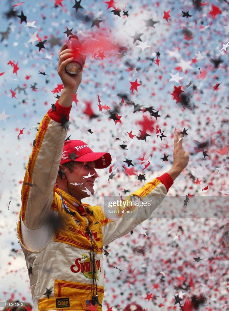 Ryan Hunter-Reay, driver of the #28 Team DHL/Sun Drop Citrus Soda Chevrolet, celebrates winning during the IZOD INDYCAR Series Honda Indy Toronto on July 8, 2012 in Toronto, Canada.
