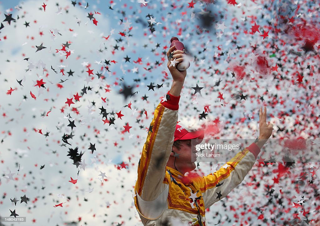 Ryan Hunter-Reay, driver of the #28 Team DHL/Sun Drop Citrus Soda Chevrolet celebrates winning during the IZOD INDYCAR Series Honda Indy Toronto on July 8, 2012 in Toronto, Canada.