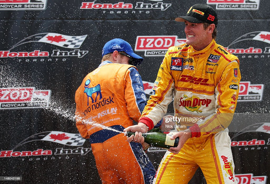 Ryan Hunter-Reay, driver of the #28 Team DHL/Sun Drop Citrus Soda Chevrolet sprays champagne after victory during the IZOD INDYCAR Series Honda Indy Toronto on July 8, 2012 in Toronto, Canada.