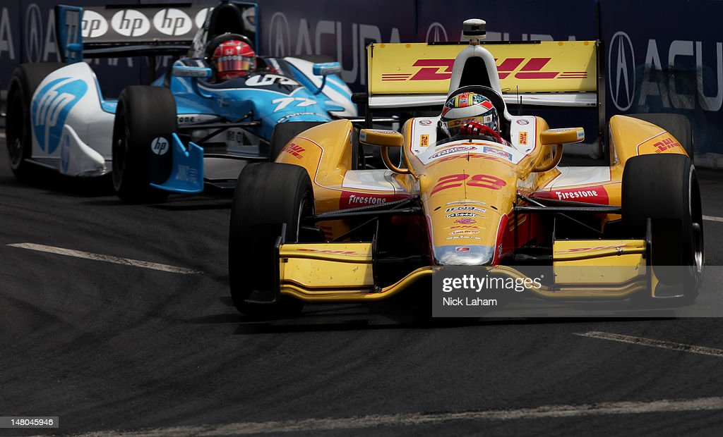 <a gi-track='captionPersonalityLinkClicked' href=/galleries/search?phrase=Ryan+Hunter-Reay&family=editorial&specificpeople=2197753 ng-click='$event.stopPropagation()'>Ryan Hunter-Reay</a>, drives the #28 Team DHL/Sun Drop Citrus Soda Chevrolet leads Simon Pagenaud of France, driver of the #77 Schmidt Hamilton HP Motorsports Honda during the IZOD INDYCAR Series Honda Indy Toronto on July 8, 2012 in Toronto, Canada.