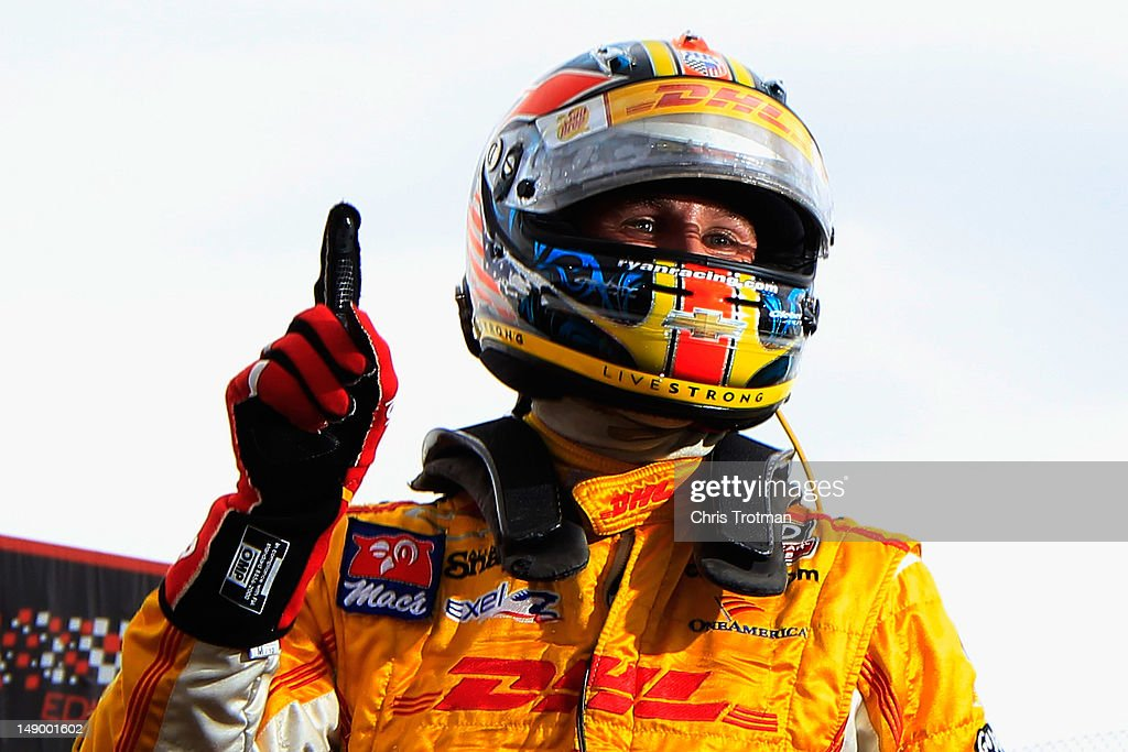 <a gi-track='captionPersonalityLinkClicked' href=/galleries/search?phrase=Ryan+Hunter-Reay&family=editorial&specificpeople=2197753 ng-click='$event.stopPropagation()'>Ryan Hunter-Reay</a> of the United States, driver of the Team DHL/Sun Drop Citrus Soda Andretti Autosport Dallara Chevrolet reacts after winning the pole position following qualifying for the IZOD IndyCar Series Edmonton Indy at Edmonton City Centre Airport on July 21, 2012 in Edmonton, Canada.