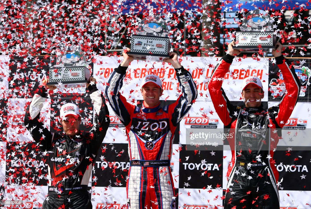 <a gi-track='captionPersonalityLinkClicked' href=/galleries/search?phrase=Ryan+Hunter-Reay&family=editorial&specificpeople=2197753 ng-click='$event.stopPropagation()'>Ryan Hunter-Reay</a> of the USA, driver of the #37 Team Izod Andretti Autosport Dallara Honda, celebrates his victory with 3rd place Will Power of Australia, driver of the #12 Verizon Team Penske Dallara Honda, and 2nd place <a gi-track='captionPersonalityLinkClicked' href=/galleries/search?phrase=Justin+Wilson+-+Piloto+de+autom%C3%B3veis+de+corrida&family=editorial&specificpeople=11906287 ng-click='$event.stopPropagation()'>Justin Wilson</a> of England, driver of the #22 Dreyer & Reinbold Racing Team Z-Line Designs Dallara Honda, during the IndyCar Series Toyota Grand Prix of Long Beach on April 18, 2010 in Long Beach, California.