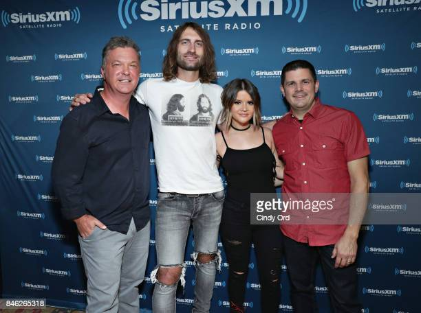 Ryan Hurd and Maren Morris pose for a photo with SiriusXM hosts Buzz Brainard and Al Skop before performing a private concert for SiriusXM at The...