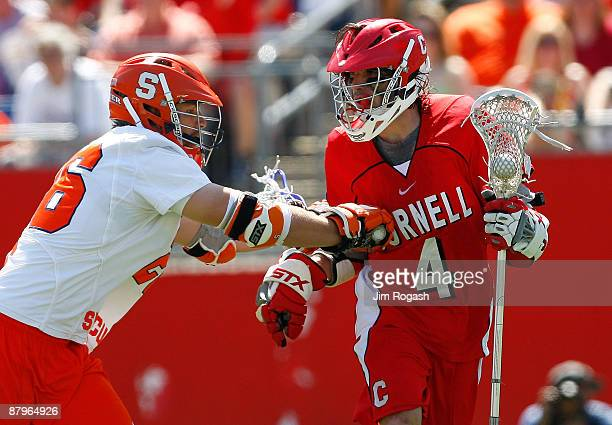 Ryan Hurley of the Syracuse Orange presses Scott Kahoe of the Cornell Big Red during the NCAA Division I Lacrosse Championship at Gillette Stadium...