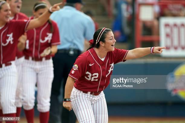 Ryan Iamurri of the University of Alabama celebrates Jackie Traina's hit against the University of Oklahoma during the Division I Women's Softball...