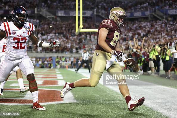 Ryan Izzo of the Florida State Seminoles scores a touchdown in the third quarter against the Mississippi Rebels during the Camping World Kickoff at...
