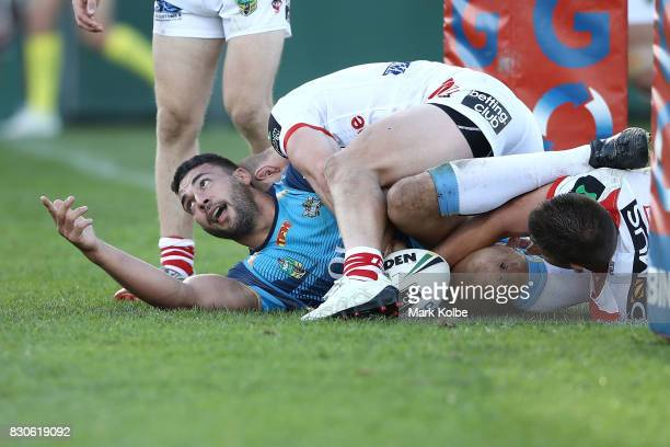 Ryan James of the Titans appeals to the referee after crossing the tryline only to have the try disallowed during the round 23 NRL match between the...