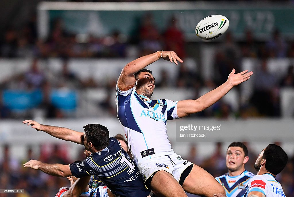 Ryan James of the Titans contests a high ball with Lachlan Coote of the Cowboys during the round 26 NRL match between the North Queensland Cowboys and the Gold Coast Titans at 1300SMILES Stadium on September 3, 2016 in Townsville, Australia.