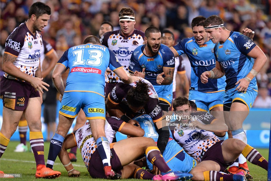 Ryan James of the Titans is congratulated by team mates after scoring a try during the round seven NRL match between the Brisbane Broncos and the Gold Coast Titans at Suncorp Stadium on April 14, 2017 in Brisbane, Australia.