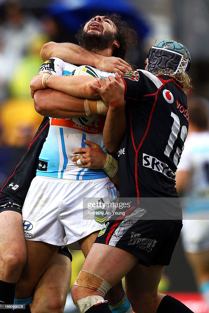 Ryan James of the Titans is tackled by Todd Lowrie of the Warriors during the round eight NRL match between the New Zealand Warriors and the Gold Coast Titans at Mt Smart Stadium on May 5, 2013 in Auckland, New Zealand.