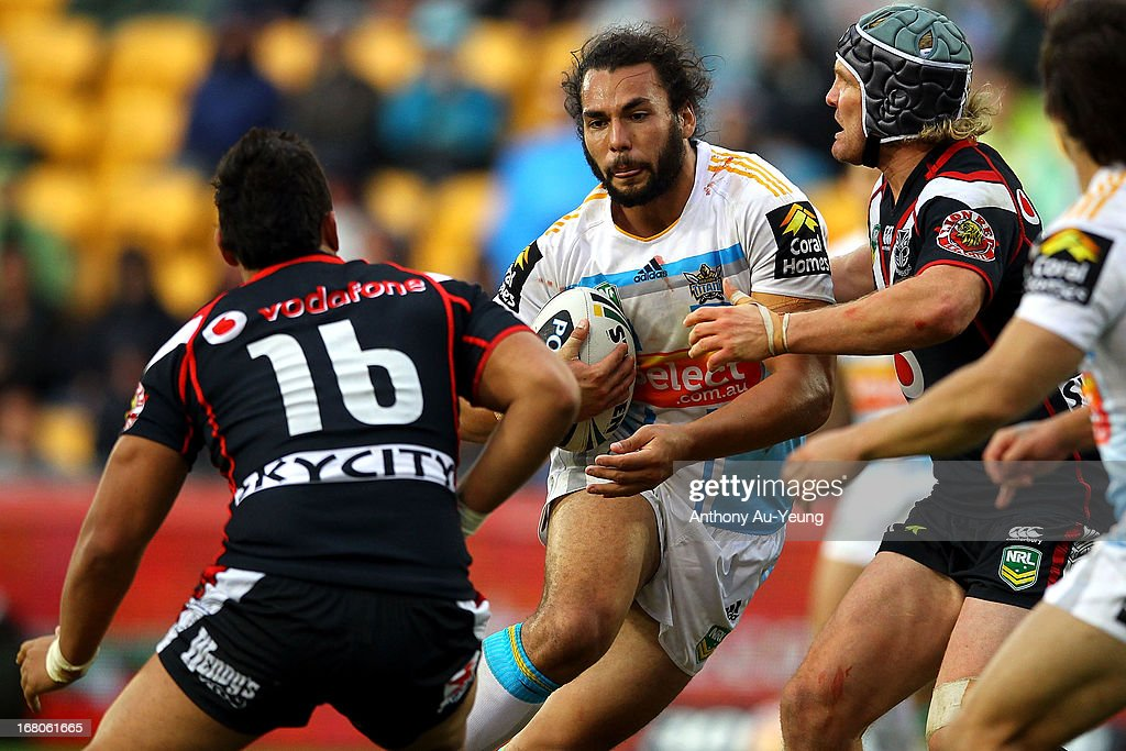 Ryan James of the Titans makes a run at Elijah Taylor and Todd Lowrie of the Warriors during the round eight NRL match between the New Zealand Warriors and the Gold Coast Titans at Mt Smart Stadium on May 5, 2013 in Auckland, New Zealand.