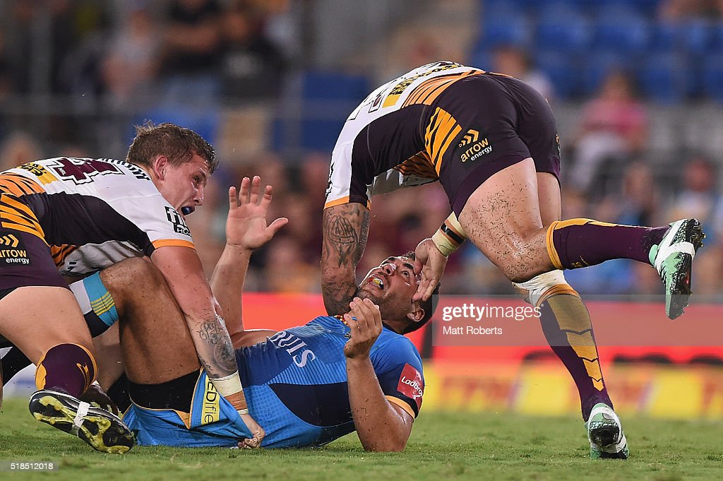 Ryan James of the Titans reacts towards Corey Parker of the Broncos during the round five NRL match between the Gold Coast Titans and the Brisbane Broncos at Cbus Super Stadium on April 1, 2016 in Gold Coast, Australia.