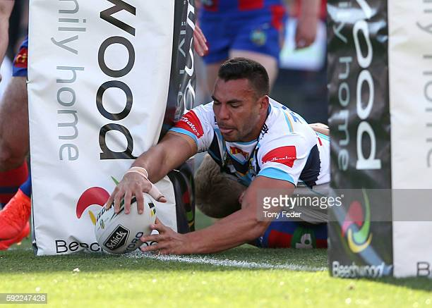 Ryan James of the Titans scores a try during the round 24 NRL match between the Newcastle Knights and the Gold Coast Titans at Hunter Stadium on...
