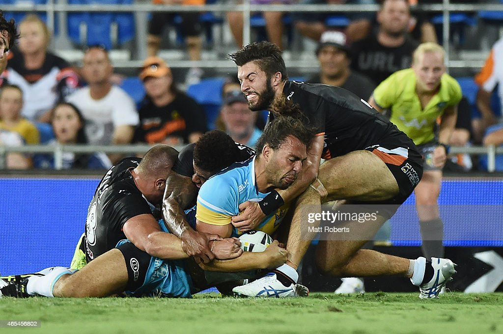 Ryan James of the Titans scores a try during the round one NRL match between the Gold Coast Titans and the Wests Tigers at Cbus Super Stadium on March 7, 2015 on the Gold Coast, Australia.