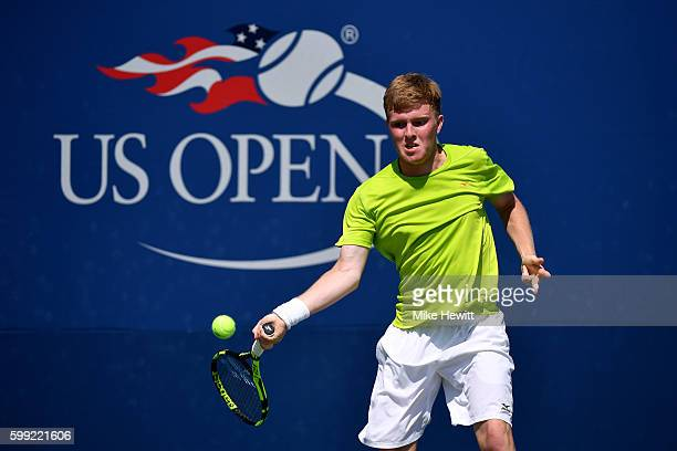 Ryan James Storrie of the United Kingdom returns a shot to Sebastian Korda of the United States during his first round Junior Boy's match on Day...