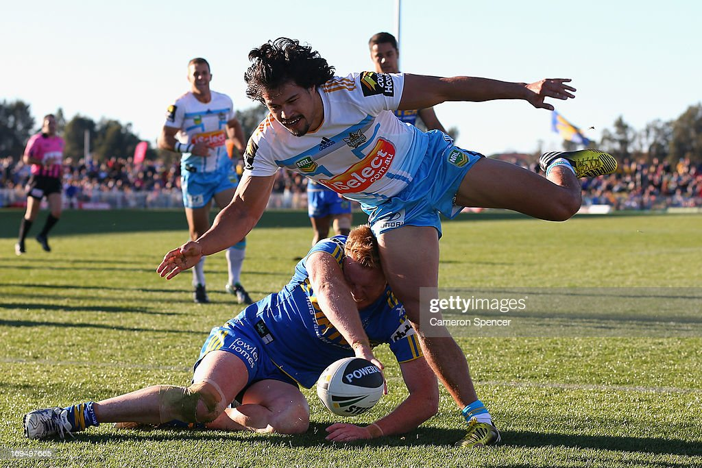 Ryan Jamesof the Titans scores a try during the round 11 NRL match between the Parramatta Eels and the Gold Coast Titans at Glen Willow Regional Sports Stadium on May 26, 2013 in Mudgee, Australia.
