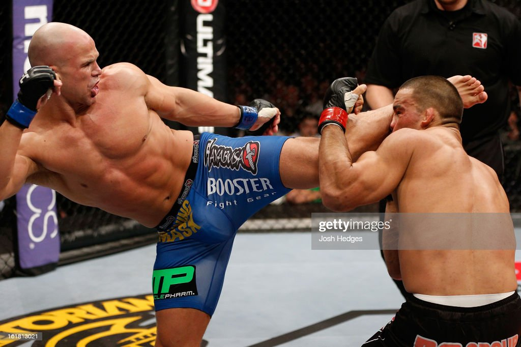 Ryan Jimmo kicks James Te Huna in their light heavyweight fight during the UFC on Fuel TV event on February 16, 2013 at Wembley Arena in London, England.
