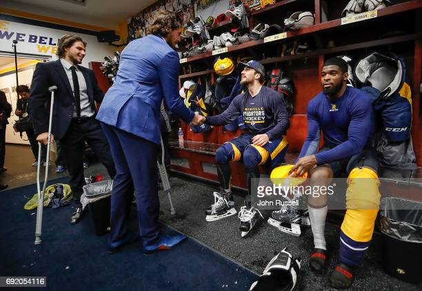 Ryan Johansen and Kevin Fiala of the Nashville Predators congratulate Roman Josi and PK Subban on a 51 win against the Pittsburgh Penguins after Game...