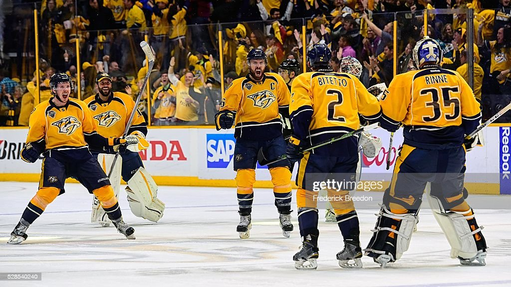 Ryan Johansen #92, Carter Hutton #30, Shea Weber #6, Anthony Bitetto #2, and Pekka Rinne #35 celebrate after winning 4-3 in the third overtime period of Game Four of the Western Conference Second Round against the San Jose Sharks during the 2016 NHL Stanley Cup Playoffs at Bridgestone Arena on May 5, 2016 in Nashville, Tennessee.