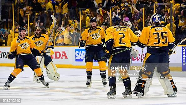Ryan Johansen Carter Hutton Shea Weber Anthony Bitetto and Pekka Rinne celebrate after winning 43 in the third overtime period of Game Four of the...